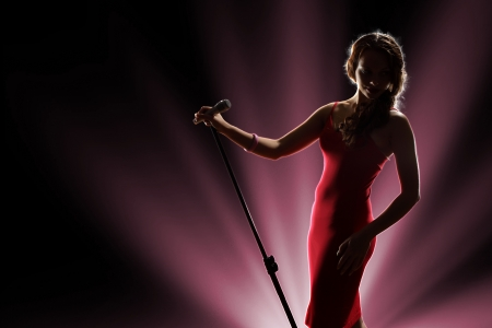 beat women: Female singer on the stage holding a microphone