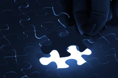 puzzle piece coming down into its place Stock Photo - 16914920