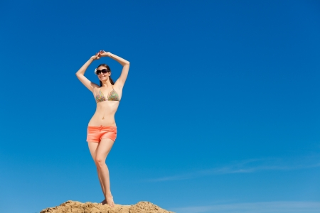 Fashion shot of beautiful woman on the beach photo