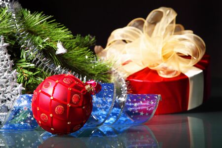 merrychristmas: New Year s still life  Decorations and ribbons on a bright color background