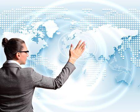 Modern Business World, A businessman navigating virtual world map photo