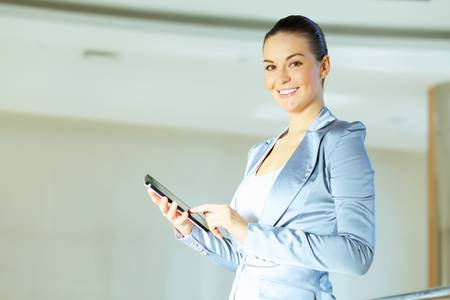 Portrait of happy smiling young businesswoman in office Stock Photo - 16951285