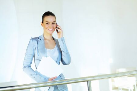 Portrait of happy smiling young businesswoman in office Stock Photo - 16951371