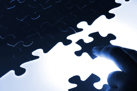 puzzle piece coming down into its place Stock Photo - 16952231