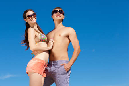 Portrait of a happy young couple enjoying at beach Stock Photo - 16951283