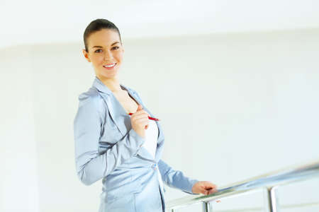 Portrait of happy smiling young businesswoman in office Stock Photo - 16951369