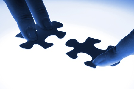 puzzle piece coming down into its place Stock Photo - 16952285
