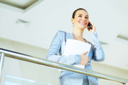 Portrait of happy smiling young businesswoman in office Stock Photo - 16951375