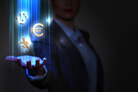 Businesswoman with financial symbols coming from her hand photo