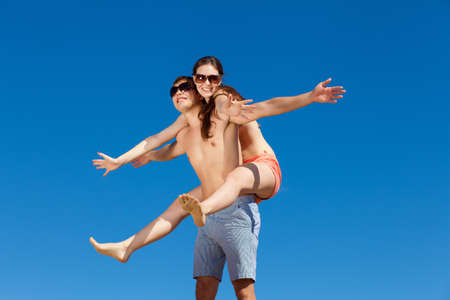 Portrait of a happy young couple enjoying at beach Stock Photo - 16951329
