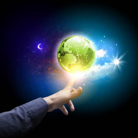 Human hand holding our planet earth glowing Stock Photo - 16955734
