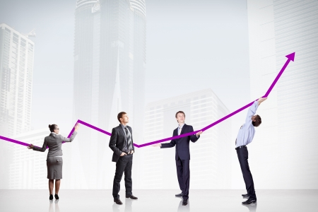 business people pushing a business graph upwards Stock Photo - 16981303
