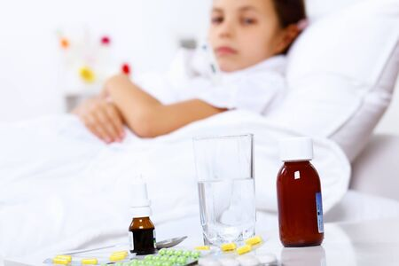 Little girl with illness at bed at home Stock Photo - 16981299
