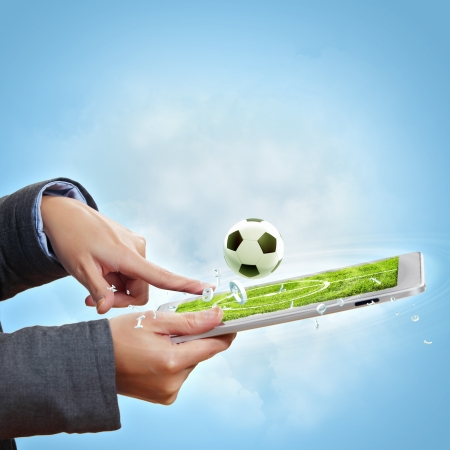 Modern wireless technology illustration with a computer device and football ball illustration