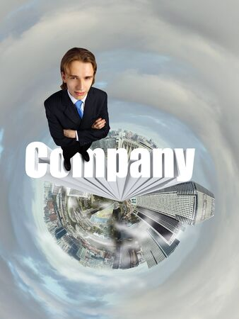 Businessman in suit standing on the word Company photo