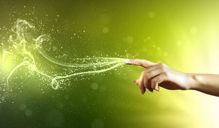 magical hand conceptual image with sparkles on colour background Stock Photo - 16982276