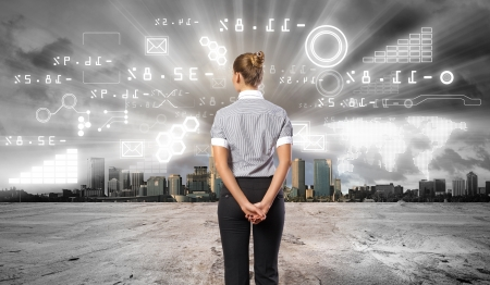 Business person standing against modern virtual technology background photo