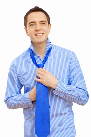 Young businessman at home preparing for a work and making his tie Stock Photo - 16982337