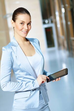 Portrait of happy smiling young businesswoman in office Stock Photo - 16982936