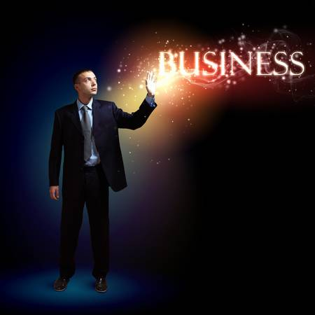 Young successful businessman holding a shining light in his hand as a symbol of success and advancement Stock Photo - 16982691