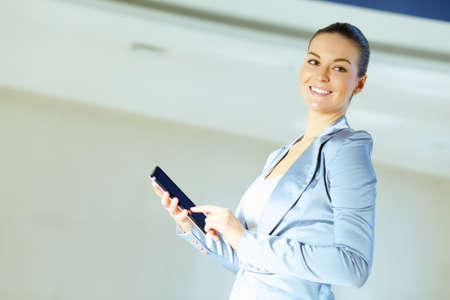 Portrait of happy smiling young businesswoman in office Stock Photo - 16982774