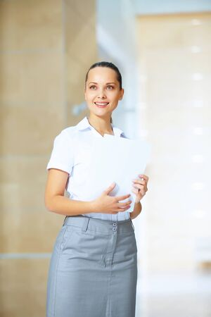 Portrait of happy smiling young businesswoman in office Stock Photo - 16982781