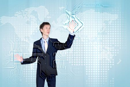 Modern Business World, A businessman navigating virtual world map Stock Photo - 16991038