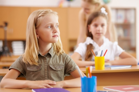 Little girl sitting and studying at school class Stock Photo - 16991064