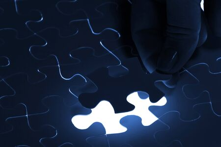 puzzle piece coming down into its place Stock Photo - 16995875