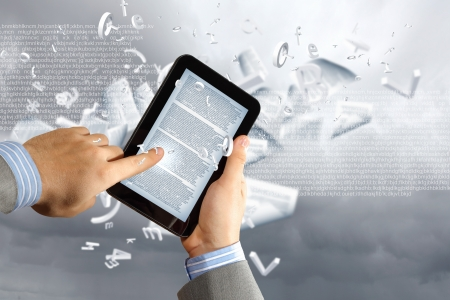 the library in the e-book concept with text pages flying out of a e-reader Stock Photo - 16995960