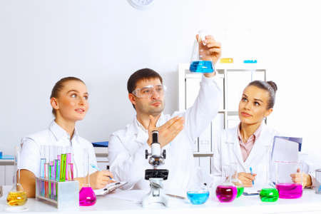 Team of scientists working with liquids in laboratory Stock Photo - 16991087