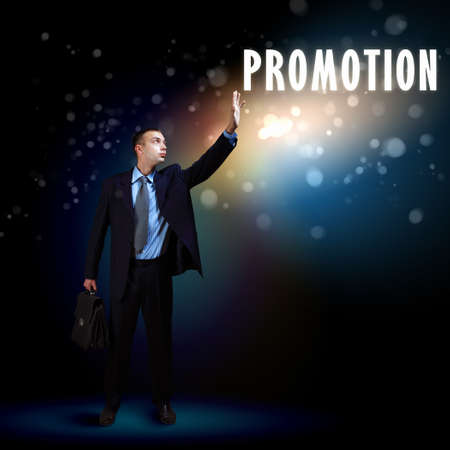 Young successful businessman holding a shining light in his hand as a symbol of success and advancement Stock Photo - 16995895