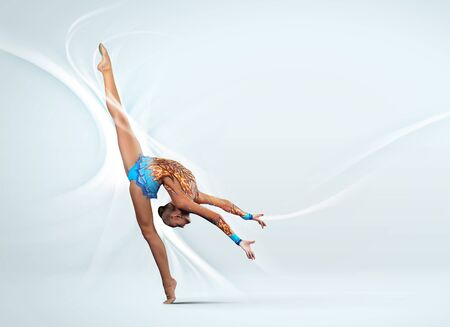 Young cute woman in gymnast suit show athletic skill on white background Stock Photo - 16996000