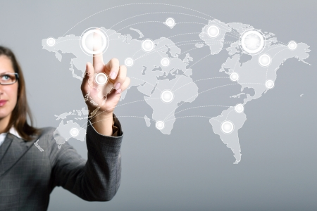 Modern Business World, A businessman navigating virtual world map Stock Photo - 16996085