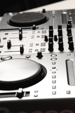 Dj mixer equipment to control sound and play music Stock Photo - 16996185