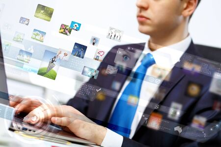 Young business person working with a notebook Stock Photo - 16997454