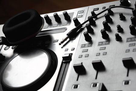 Dj mixer equipment to control sound and play music photo