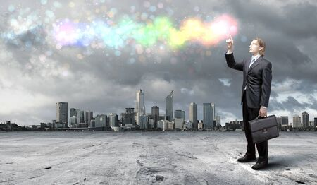 Business concepts the colourful light splashes at your fingertips photo