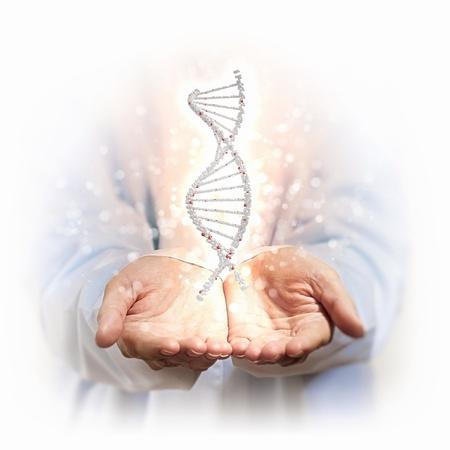 acido: Imagen de la cadena de ADN contra el fondo con manos de hombre