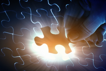 puzzle piece coming down into its place Stock Photo - 17022133
