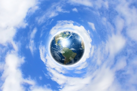 Planet earth against blue cloudy sky background  Elements of this image furnished by NASA  photo