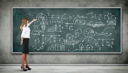 blackboard background: Business person standing against the blackboard with a lot of data written on it