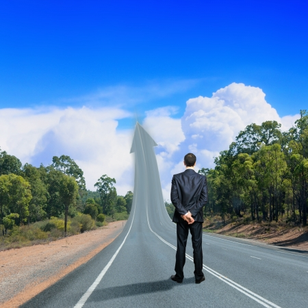 Concept of the road to success with a businessman standing on the road Stock Photo - 17055790