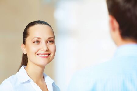 Portrait of happy smiling young businesswoman in office photo