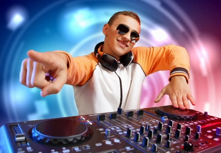 dj: DJ with a mixer equipment to control sound and play music Stock Photo