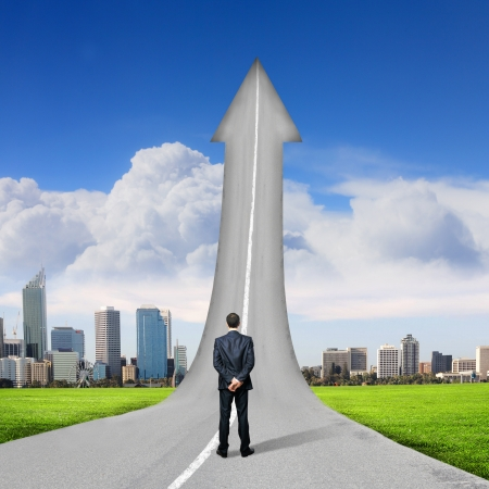 Concept of the road to success with a businessman standing on the road Stock Photo - 17055788