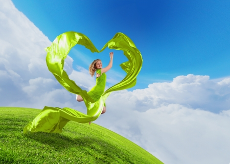 Female dancer and green heart symbol from fabrique Stock Photo - 17055540