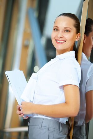 Portrait of happy smiling young businesswoman in office Stock Photo - 17055000