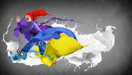 Modern style dancer jumping and paint splashes Illustration photo