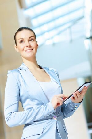 Portrait of happy smiling young businesswoman in office Stock Photo - 17054962